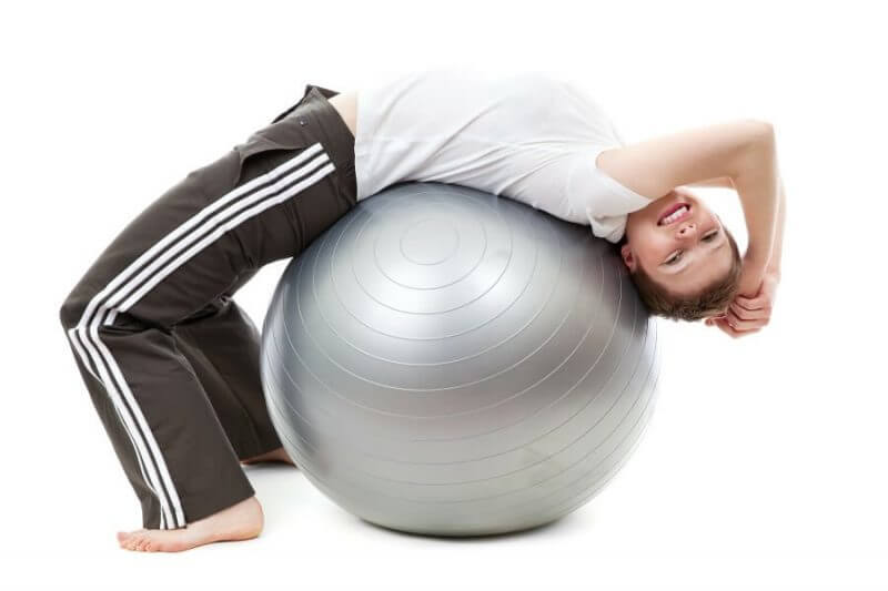 lady working out using a gym ball