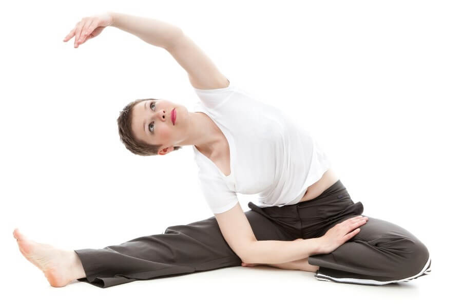 a lady doing yoga on the floor