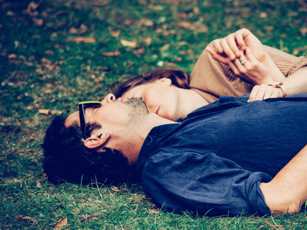 couple asleep on ground