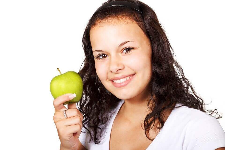lady  holding an apple