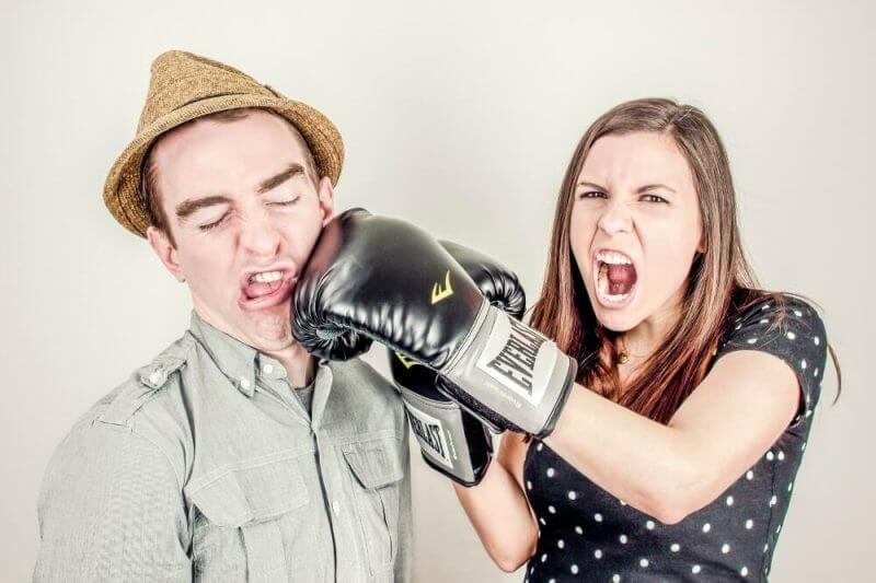 a lady punching man