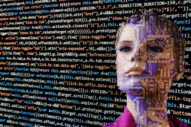 coding language and a face on the background