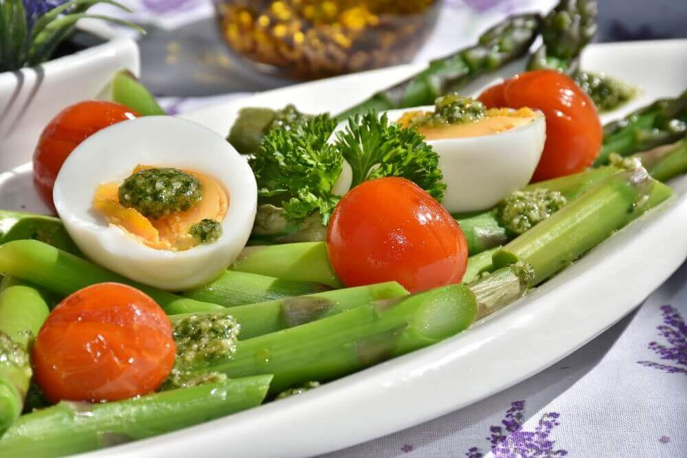 vegetables on a white plate and boiled eggs