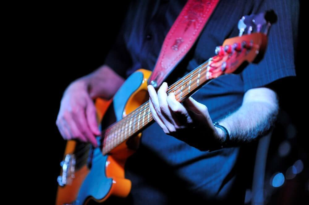 a guy playing an electric guitar