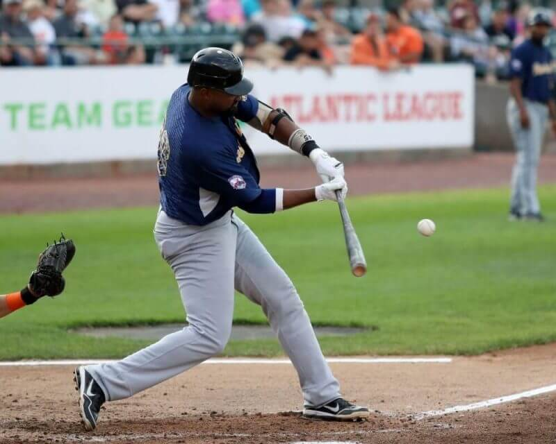 baseball player hitting a baseball with a bat