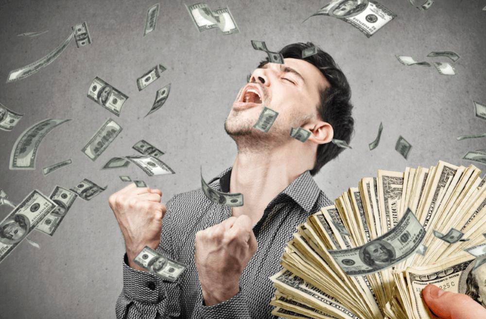 man celebrating for money
