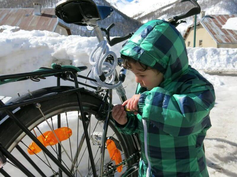a kid trying to repair a bicycle