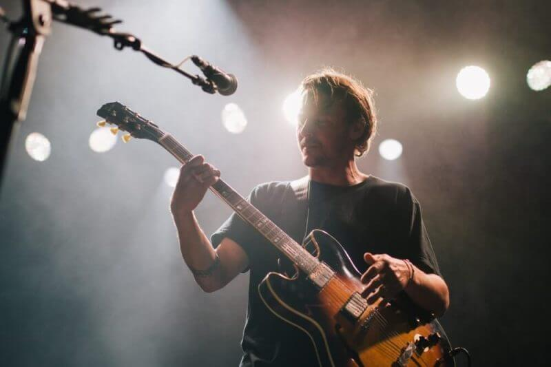 artist playing guitar