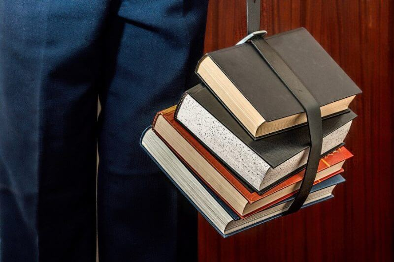 books tied together in a belt