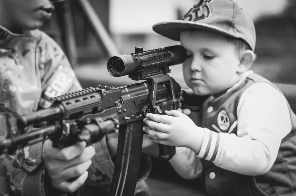 kid holding a rifle