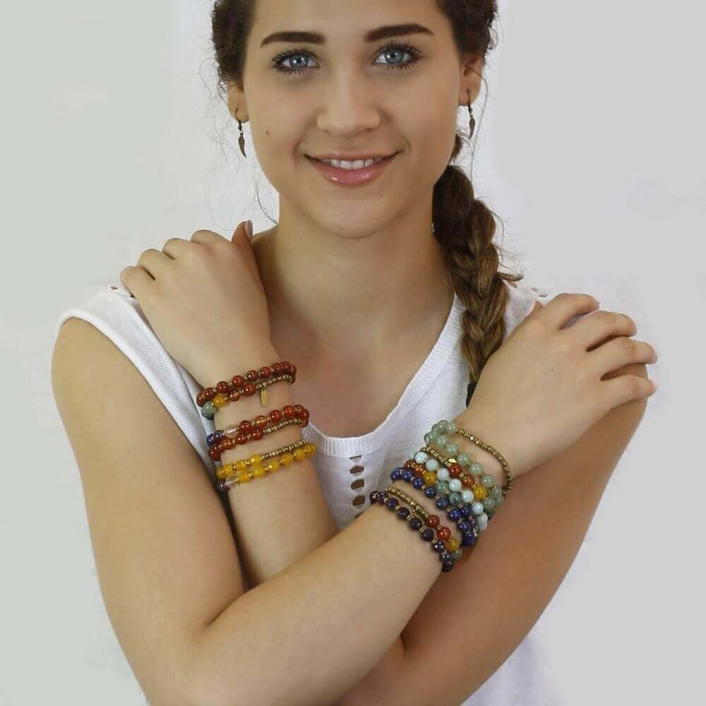 a smiling lady wearing the bracelet