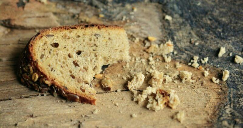 bread crumbles on an old table