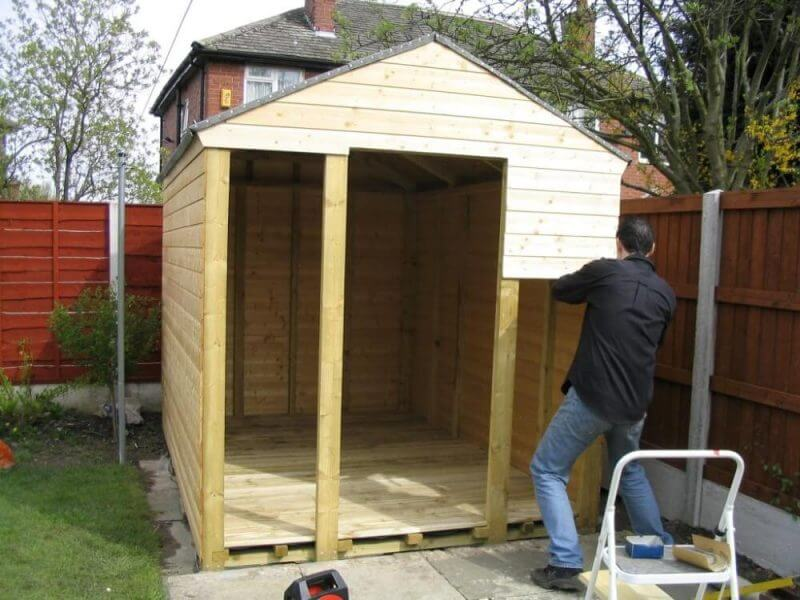 a man making a shed