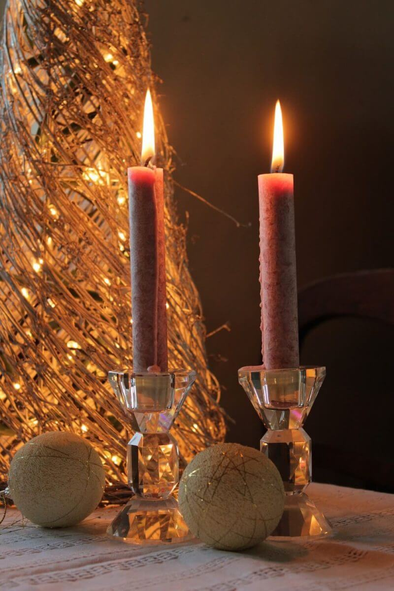 candles lit and placed on a candle stand