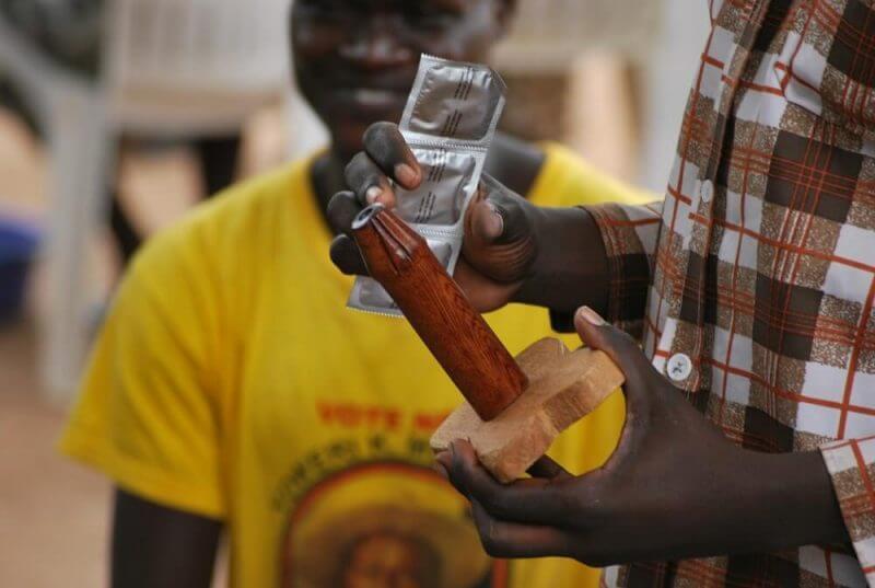 a man holding condoms