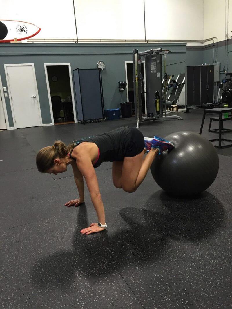 a woman trainig using a plastic ball