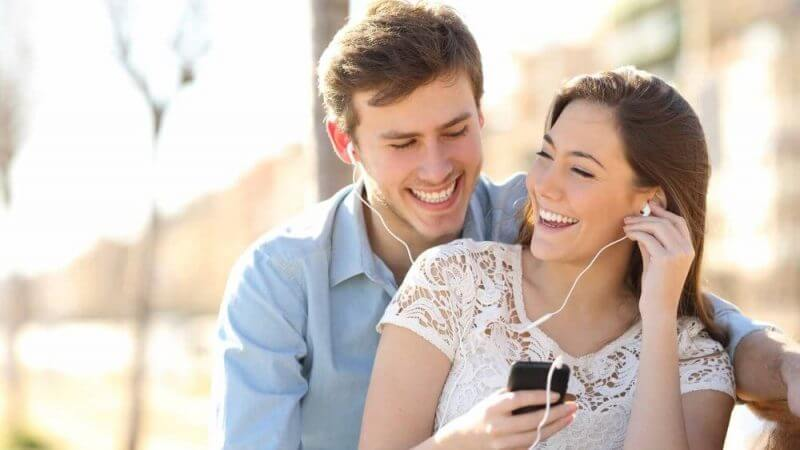 couple using headphones
