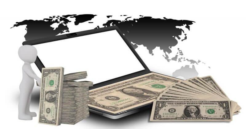 money on a laptop
