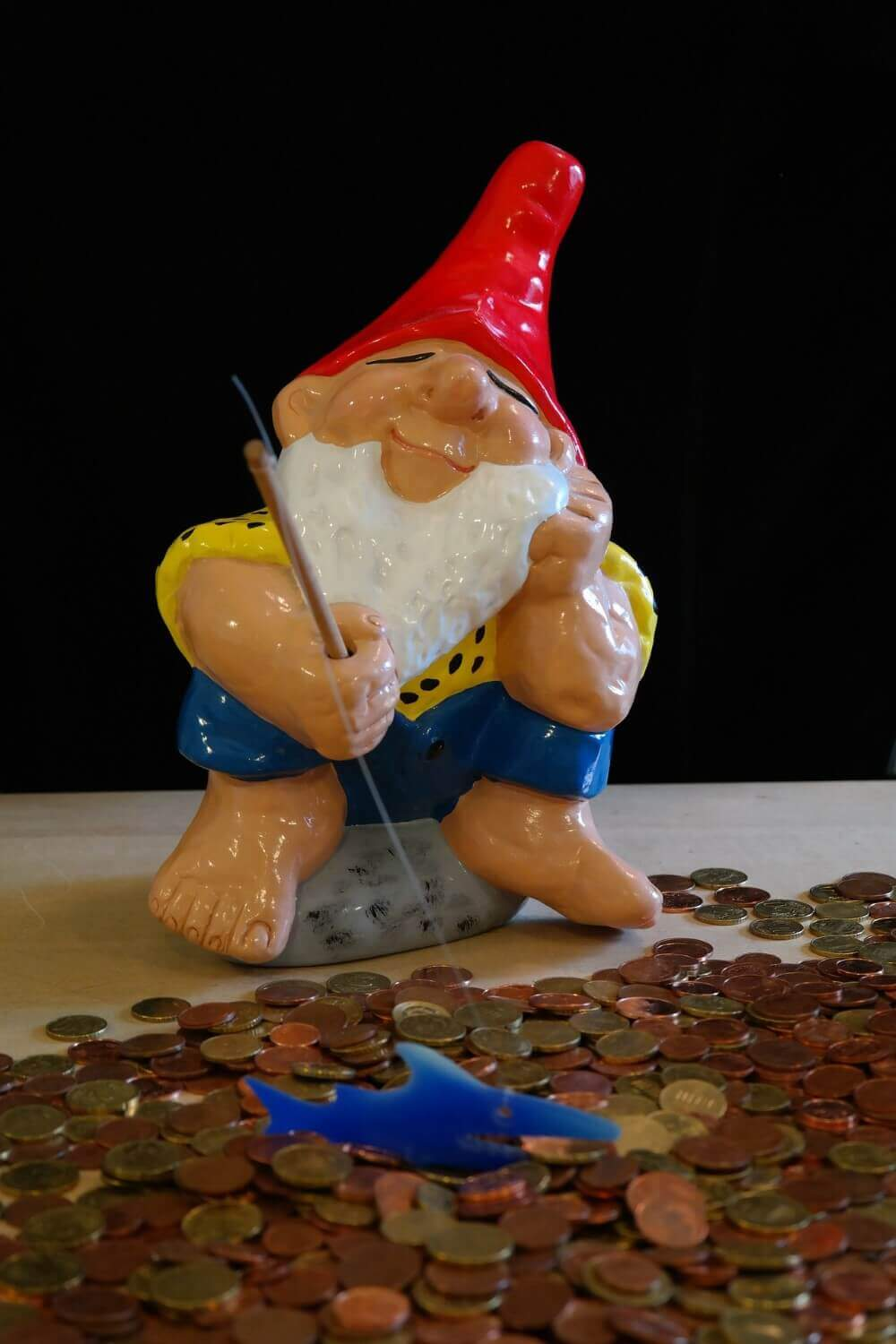 a model of an old man with some coins