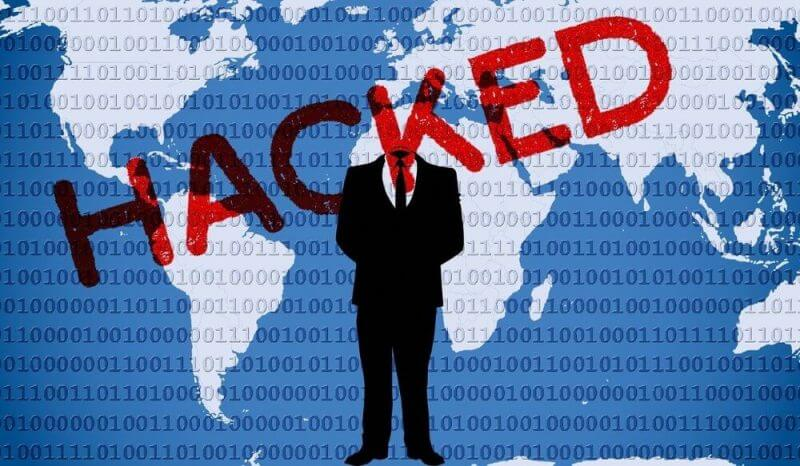 word hacked and a man with a suit in the background