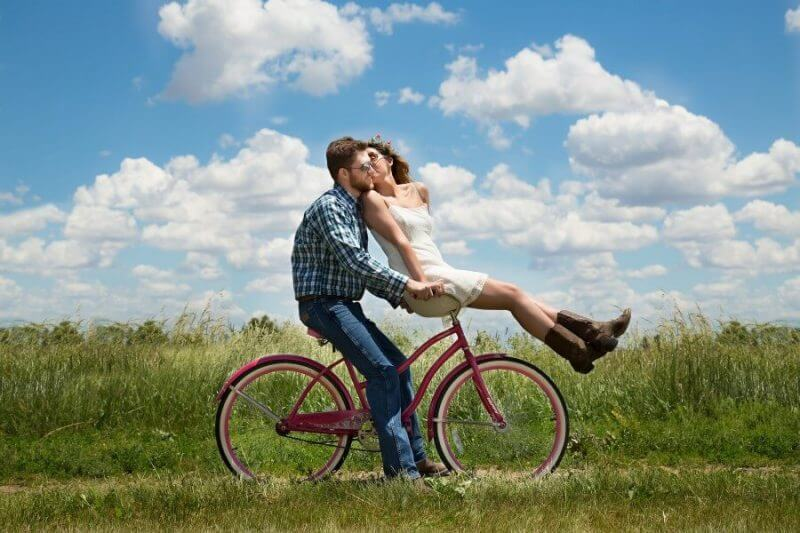 couples riding on a bicycle