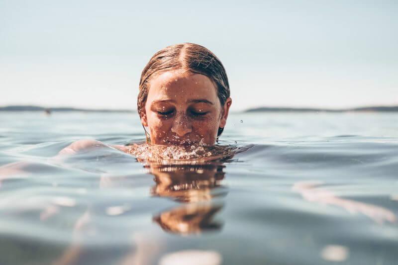 Woman swimming.