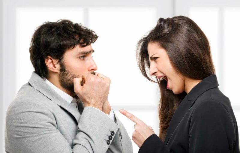 Woman yelling out to a scared man