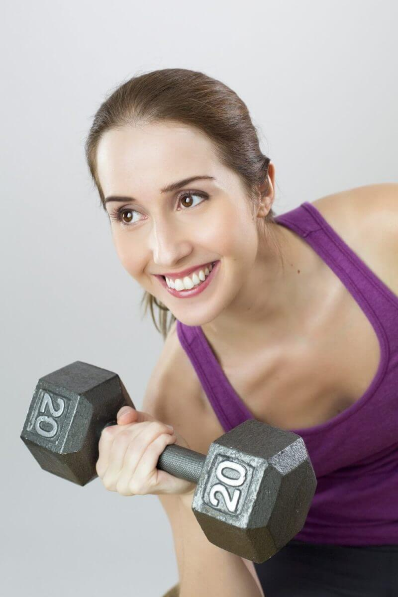 a cute lady lifting weights