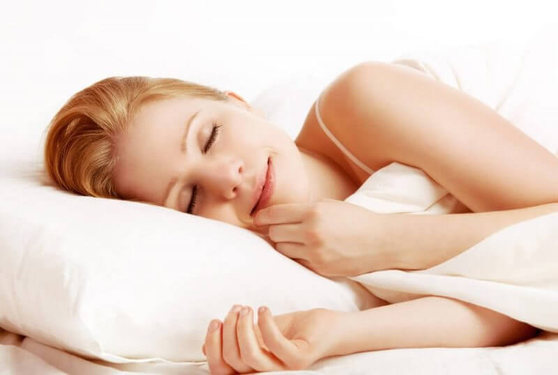 a woman sleeping while smilling