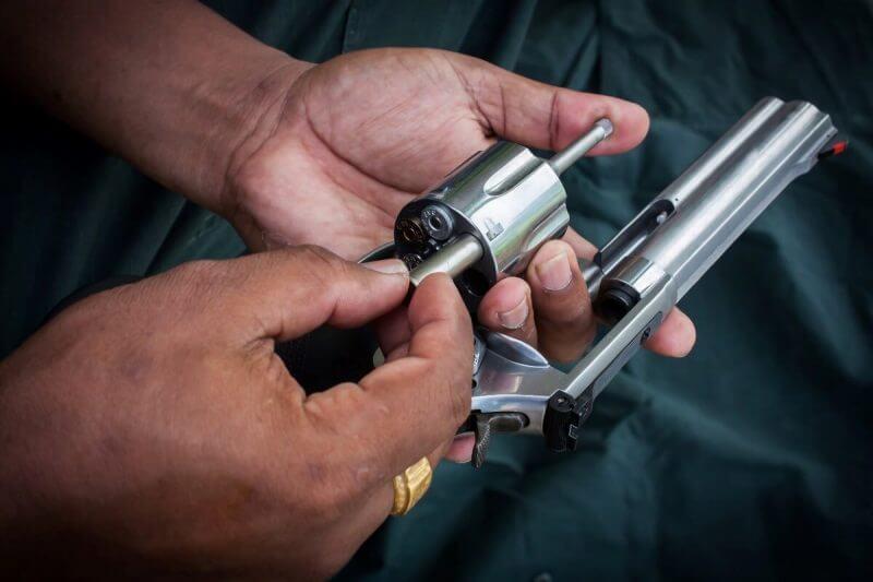 hand man holding show gun storage cylinder .357 magmun of revolver handgun