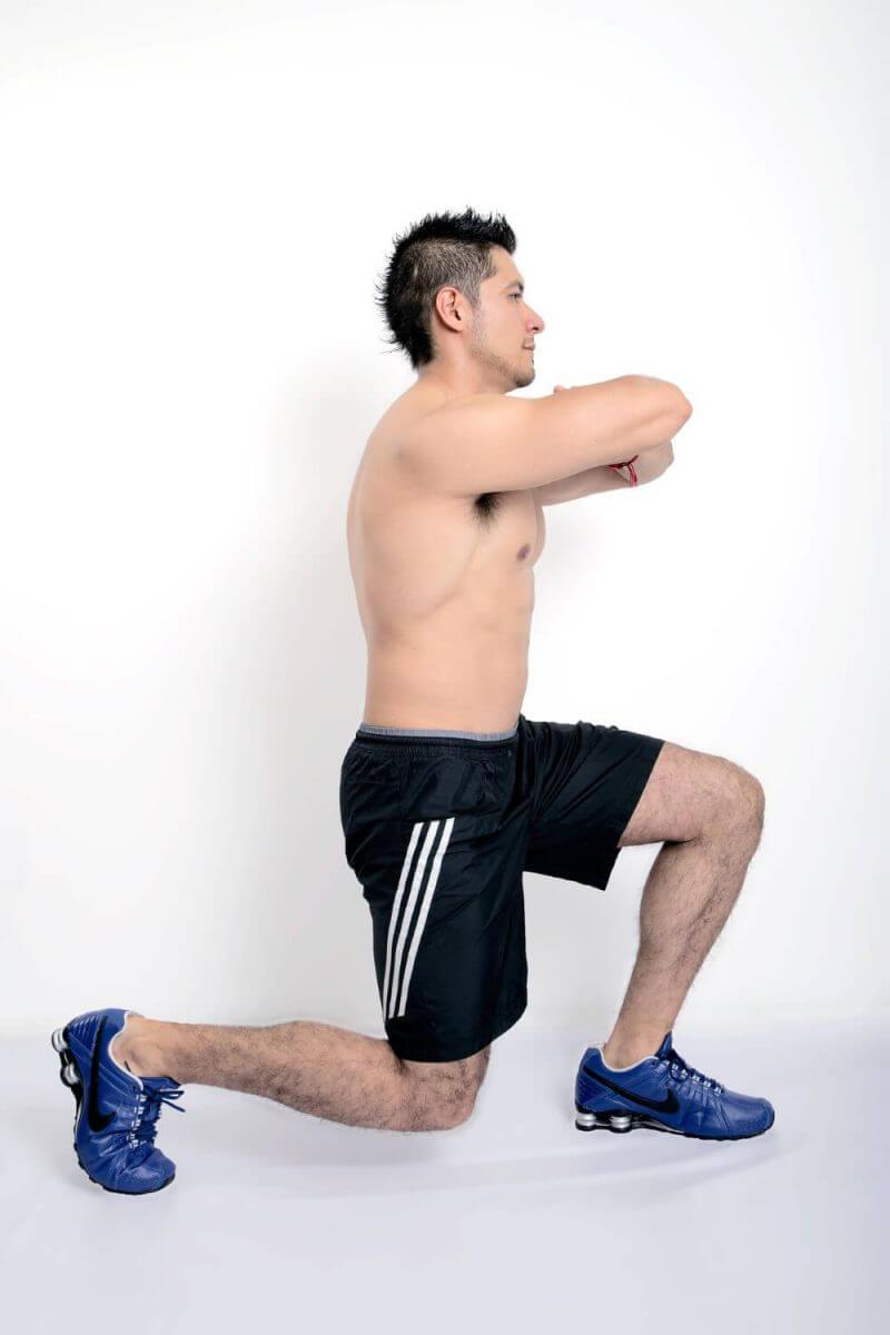 musculine man kneeing