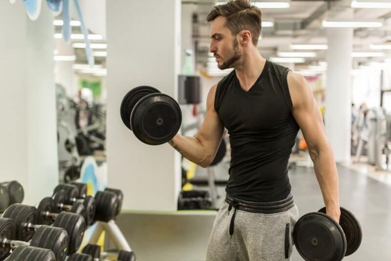 musculine man doing dumbbell
