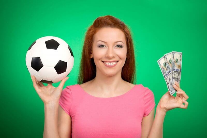 woman holding a ball and money