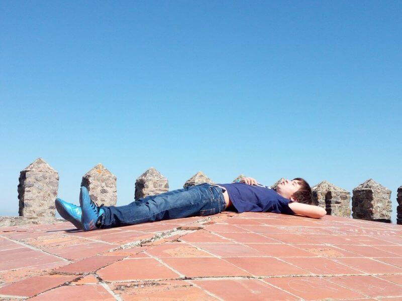 man lying on a concrete floor