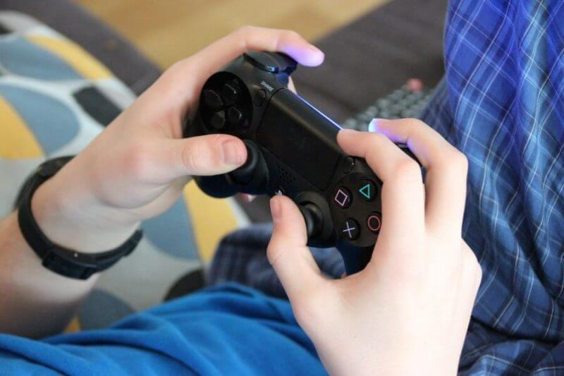 hands on a playstation controller