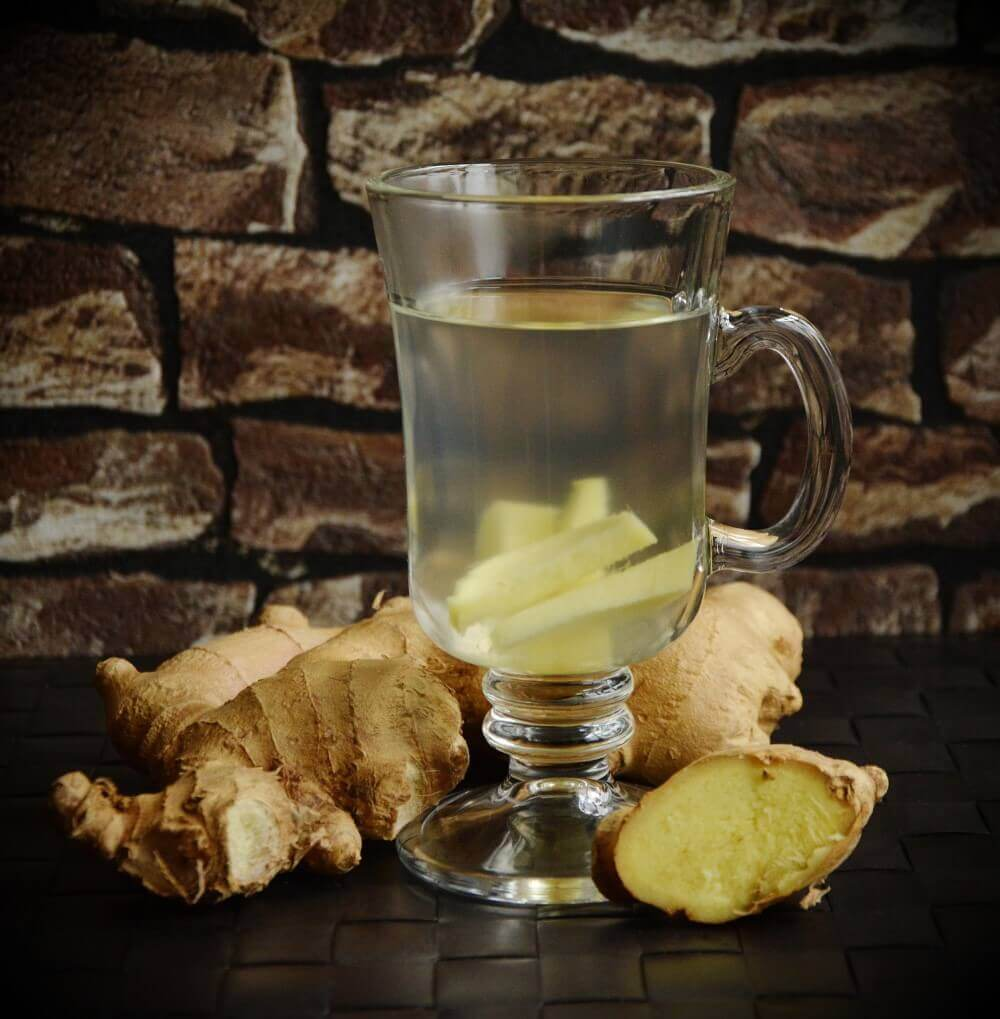 a glass full of water and ginger