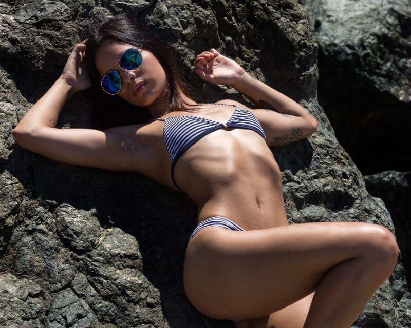 a lady lying on rocks