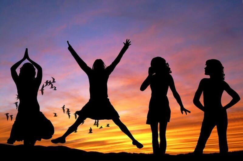 women dancing under the sunset