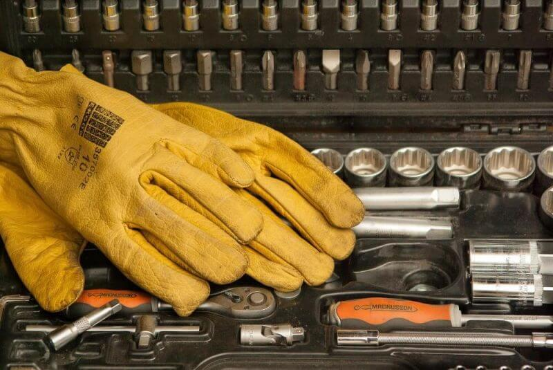 mechanic tools and yellow gloves