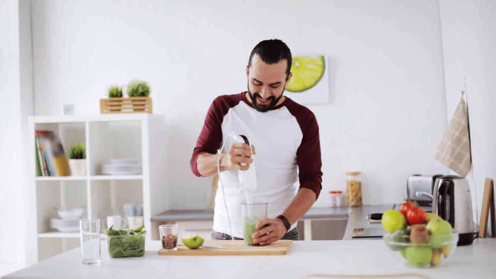 man preparing smoothie