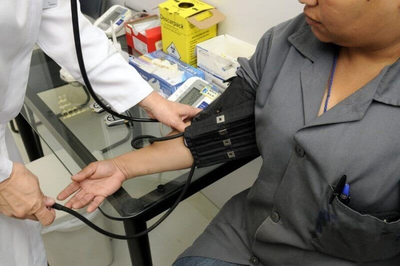 a doctor examining a patient on the hand