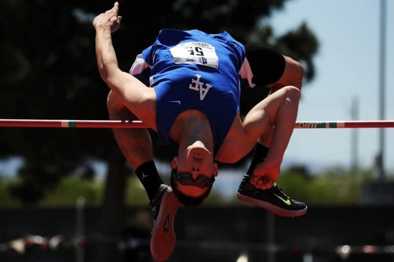 a man jumping high jump