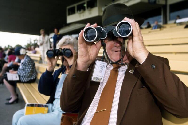 man and woman using binoculars