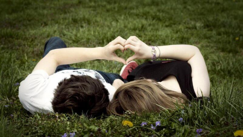lovers lying on the ground