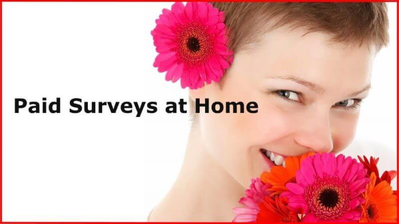 paid surveys at home and a beautiful woman in the background