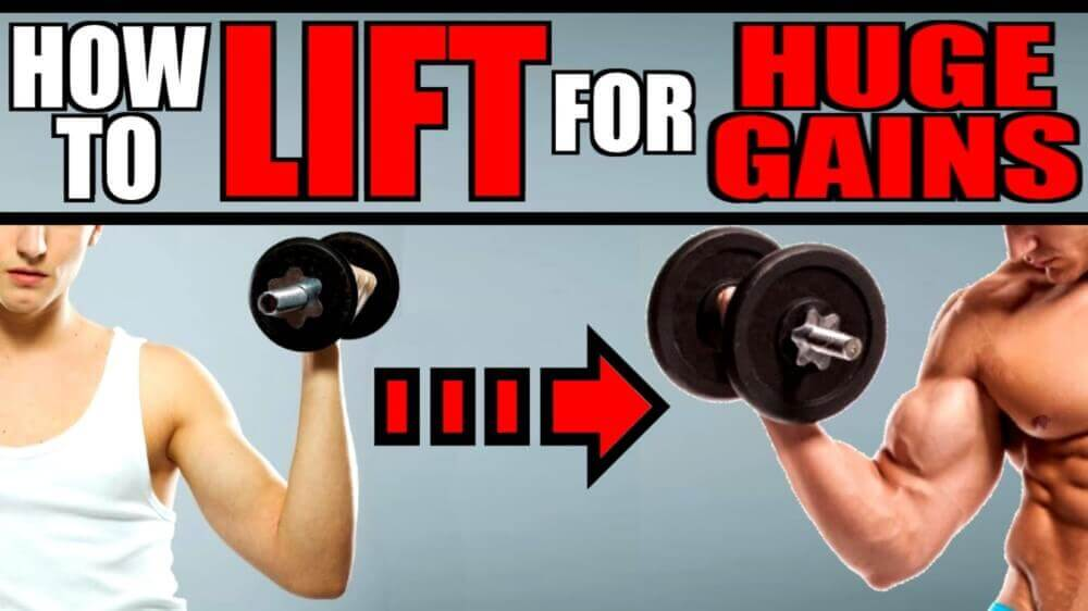 how to lift for huge gains. Two men lifting weights