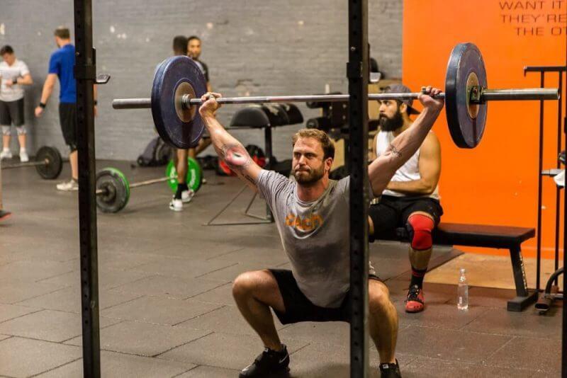 man lifting weighs