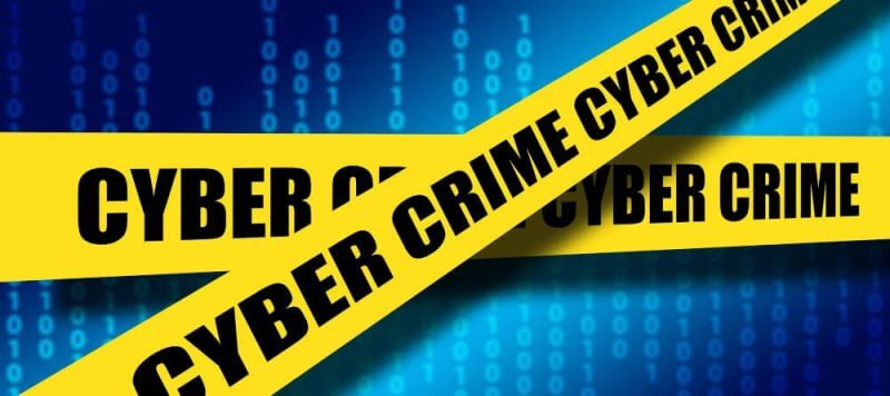 cyber crime on yellow ribbins on a blue background