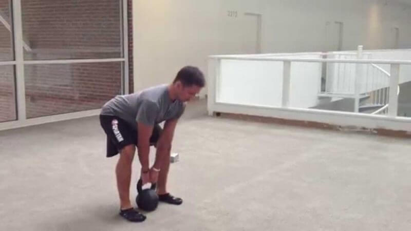 man lifting a kettlebell