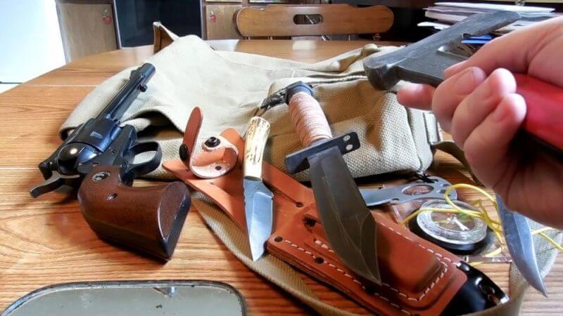 an axe,knives and a gun